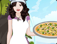 Selena Cooking Hummus Pizza